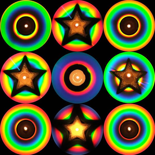 Компакт-диски, на которых стоят свечи разной формы